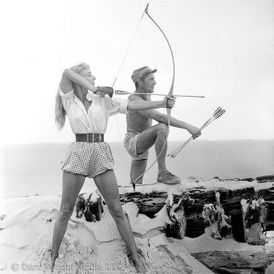 Dare's Story Photo of Dare Wright and Blaine Shooting Arrows on Ocracoke