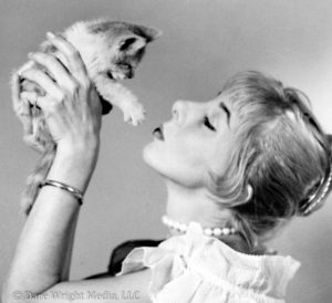 Dare's Story Photo of Dare Wright Holding a Kitten in New York